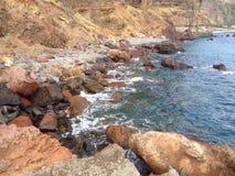 Desert Beach of Rocks Stock Image