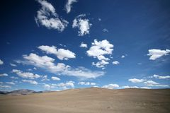 Desert and blue sky Royalty Free Stock Photos