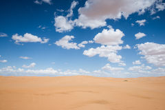 Desert and blue sky Royalty Free Stock Photo