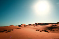 Desert, blue sky and sun. Landscape of sahara desert dunes in back light Stock Photo