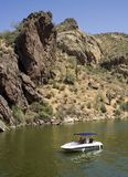 Desert boat. People boating on a lake in the desert Stock Photos