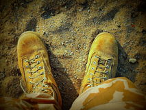 Desert boots in sandbox Stock Photo