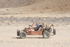 Desert buggy racing across ground Royalty Free Stock Photography