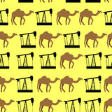 Desert camels and oil pumps seamless pattern. Vector background Royalty Free Stock Photos