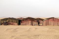 Desert camp. Morocco, Erg Chebbi: traditional berber desert tents. Erg Chebbi is of Morocco's two Saharan ergs, large dunes formed by wind-blown sand Royalty Free Stock Photography