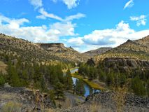 Desert Canyon Panorama. View in the Upper Palisades section of the Crooked River Canyon south of Prineville, OR - Chimney Rock in center background and Chimney royalty free stock photo