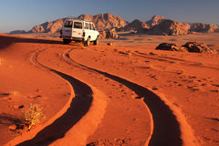 Desert car. Taking a jeep tour in the Wadi Rum desert in Jordan around sunset hour royalty free stock photography