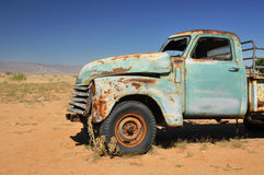 Desert car wreck Stock Photos
