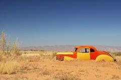Desert car wreck stock photo