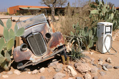 Desert car wreck. Old and rusty car wreck at the last gaz station before entering the namibian desert stock images