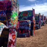 Desert cars. Spray painted cars buried in the southwest desert Stock Image