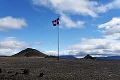Desert in Central Highlands of Iceland and Islandic national flag in top of the high pole. The landscape of Odadahraun desert in Central Highlands of Iceland and royalty free stock photography