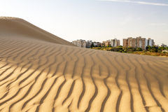 Desert and a city . Royalty Free Stock Photo