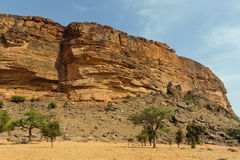 Desert and cliff in Bandiagara Escarpment Royalty Free Stock Photo