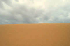 Desert and cloud Stock Photography