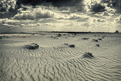 Desert clouds. Waves in the sand and clouds in the sky Royalty Free Stock Photos