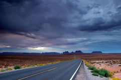 Desert cloudscape. Desert road during the summer storm Stock Photos