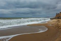 Desert cloudy coast of the autumn beach. Stock Photography