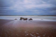 Desert cloudy coast of the autumn beach. Stock Photo