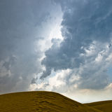 Desert and cloudy sky. It is going to rain in the desert of Kubuq, Inner Mongolia, China royalty free stock photography