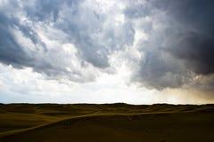 Desert and cloudy sky. It is going to rain in the desert of Kubuq, Inner Mongolia, China stock photo