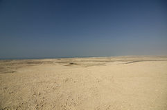 Desert coastline between Dubai and Abu Dhabi. United Arabic Emirates Royalty Free Stock Photography