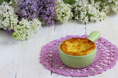 Desert. Cottage cheese on a ceramic casserole baking Shallow DOF stock photography