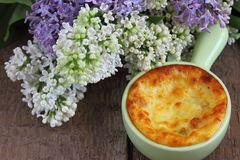 Desert. Cottage cheese on a ceramic casserole baking Shallow DOF royalty free stock photography