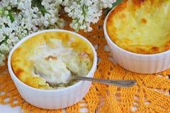 Desert. Cottage cheese on a ceramic casserole baking Shallow DOF stock image