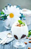 Desert. With cream and dry almond in glass Stock Photography