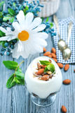 Desert. With cream and dry almond in glass Royalty Free Stock Photo
