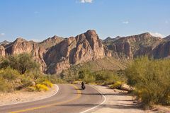 Desert Cruising. Motorcycle driving through Arizona on a sunny afternoon royalty free stock photography