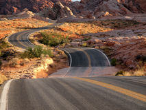 Desert Dips. Red rocks, S curves and desert wash dips at Valley of Fire Nevada Royalty Free Stock Photo