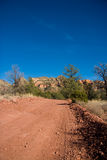 Desert dirt road Stock Photography