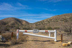 Desert Dirt Road Closed. Dirt road in the desert closed to traffic for visitors Stock Photography
