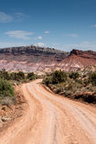 Desert dirt road to Paria, Utah ghost town. Dirt road with mountains behind Royalty Free Stock Photography