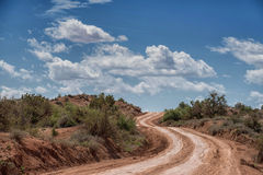 Desert dirt road to Paria, Utah ghost town. Dirt road winding up hill, on way to Paria, Utah ghost town Stock Photography