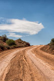 Desert drit road, Utah. Looking up dirt road to clouds and sky behind Stock Photo