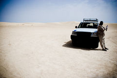 Desert driver. Off road  vehicle and its driver in the Sahara desert Royalty Free Stock Photos