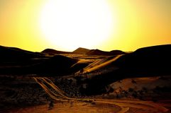 Desert between Dubai and Abu Dhabi. The sun is slowing down. In a revised version Royalty Free Stock Photography