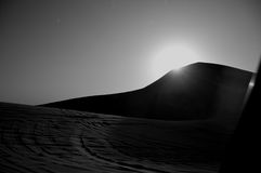 Desert between Dubai and Abu Dhabi. The sun is slowing down Stock Photography
