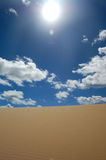 Desert dune and white clouds Royalty Free Stock Photography