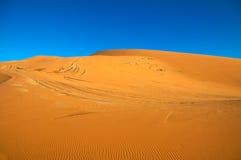 Desert Dunes. Sahara desert sand dunes with blue sky Stock Image