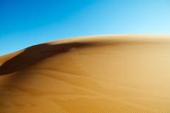 Desert Dunes. Sahara desert with blue sky Stock Image