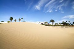 Desert dunes hotel in sunset. Royalty Free Stock Photo
