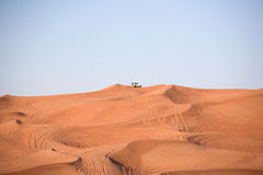 Desert dunes, an off-road car alone Stock Image