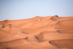 Desert dunes, an off-road cars Stock Photography