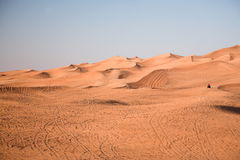 Desert dunes, an off-road vehicle Royalty Free Stock Images