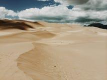 Desert dunes on sunny day Stock Photo