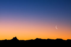 Desert at Dusk. A simple desert landscape after sunset with plenty of copy space Royalty Free Stock Images